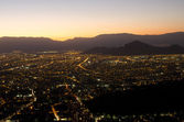 The city at night, among the mountains — Stock Photo