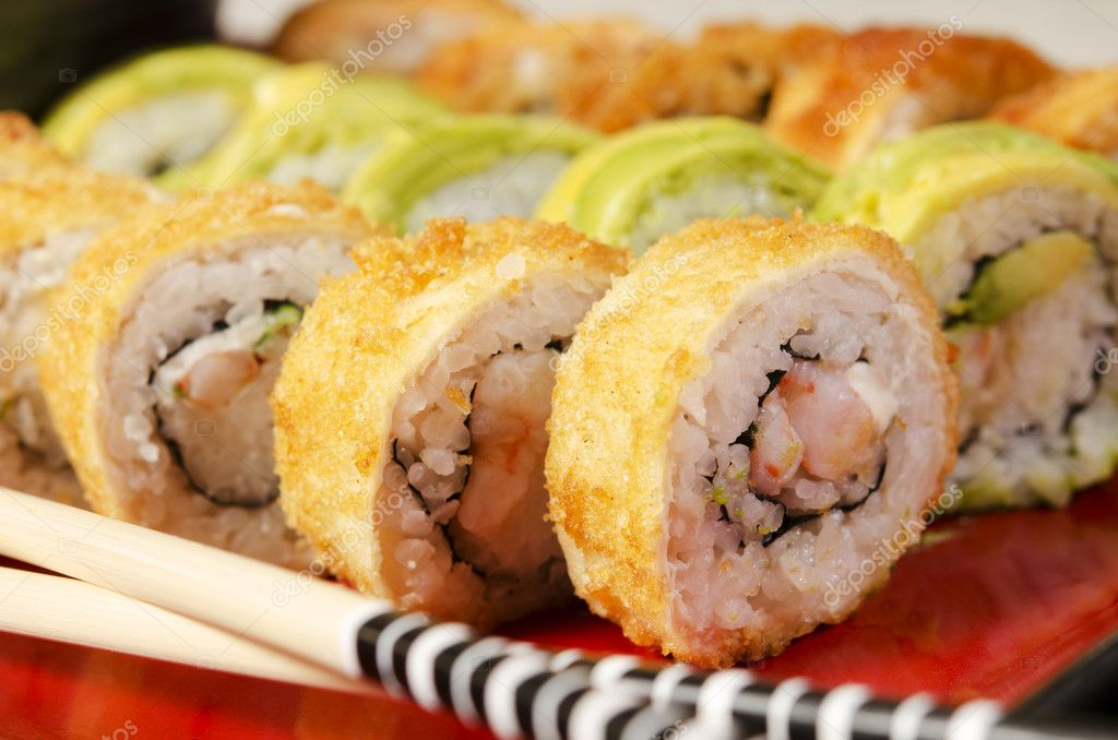 Studio shot of a group of sushi rolls, on a natural setup.  Stock Photo #9839104