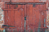 Red wooden gate — Stock Photo