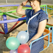 Stock Photo: With balloons girl seaman