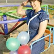 With balloons girl the seaman — Stock Photo