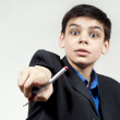 Boy shows his hand with a pen — Stock Photo