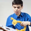 Boy with a book and a toy on a gray background — Stock Photo #10092351