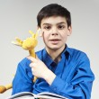 Boy with a book and toy — Stock Photo