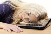 Girl sleeps on a laptop — Stock Photo