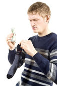 The guy put the money in a sock — Stock Photo