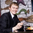 A handsome guy in the restaurant happy eating sushi - Stock Photo