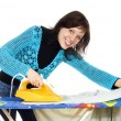 Beautiful girl ironing clothes - Stock Photo