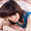 Beautiful girl on the bed with laptop — Stock Photo #10249866