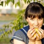 Brunette girl eating an apple — Stock Photo #10249992