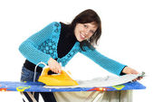 Beautiful girl ironing clothes — Stock Photo