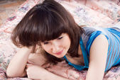 Beautiful girl on the bed with laptop — Stock Photo
