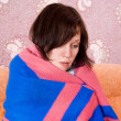 Girl fell ill and wrapped in a blanket - Stock Photo