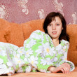 Girl lying on the sofa at home — Stock Photo