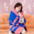 Girl wrapped in a blanket with a thermometer — Stock Photo