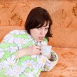 The girl fell ill and drinks tea — Stock Photo