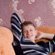 The guy is resting on the couch — Stock Photo