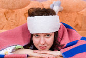 Girl is sick and lying on the sofa — Stock Photo