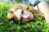 On the nature of the beautiful red-haired girl in the grass — Stock Photo