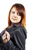Redhead business woman holding glasses — Stock Photo
