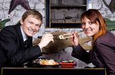 The guy with the girl eat sushi — Stock Photo