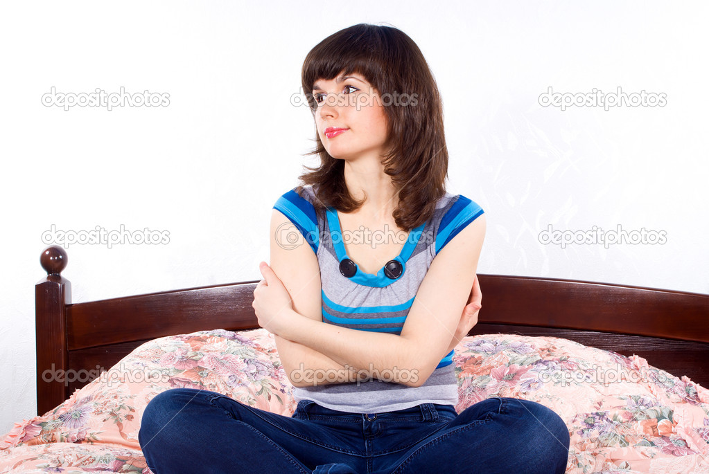Beautiful girl sitting on a bed  Stock Photo #10250166