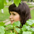 Stock Photo: Beautiful girl hid in lush greenery, in nature
