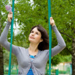 Beautiful girl ride on a swing, in nature — Stock Photo