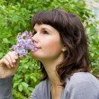 Beautiful girl smell the lilacs, in nature — Stock Photo