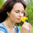 Beautiful girl sniff flowers, in nature — Stock Photo #10618495