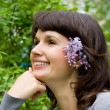 Beautiful girl, in her hair lilac, in nature — Stock Photo