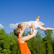 Father raise daughter on hands, in nature — Stock Photo