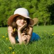 Girl was lying on a green meadow — Stock Photo