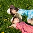 Girls lie on the grass, in nature — Stock Photo