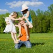 Stock Photo: Family plays on nature