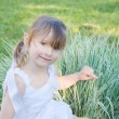 The little girl on the nature — Stock Photo