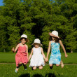 Three girls jumping, in nature — Stock Photo