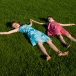 Stock Photo: Two of girls slept on grass, in nature