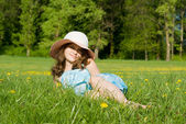 A young girl was lying in the meadow — Stock Photo