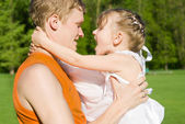 The father holds the daughter on hands, in nature — Stock Photo