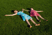 Two of the girls slept on the grass, in nature — Stock Photo