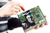 The guy the repair of the CD drive — Stock Photo