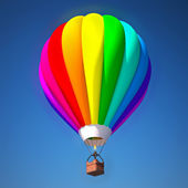 Colorful air balloon against blue — Stock Photo