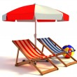 Two beach chairs under sunshade — Stock Photo #9516542