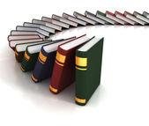 Books falling like dominoes — Stock Photo
