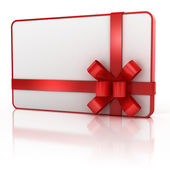 Blank gift card with red ribbon — Stock Photo