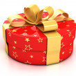 Stock Photo: Red gift box with golden ribbon over white background