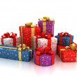 Colorful gift boxes over white background — Stock Photo