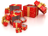 Open red gift boxes with golden ribbon over white background — Стоковое фото