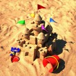 Sand castle with beach toys — Stok fotoğraf
